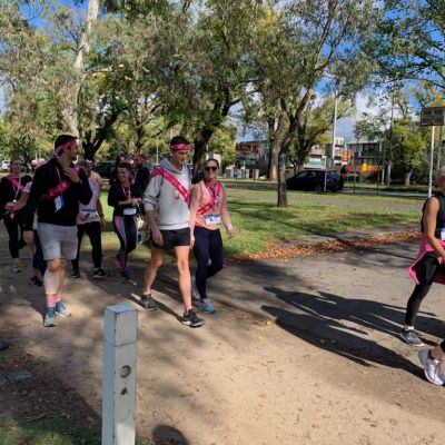 Men and women walking for breast cancer research in Princes Park, Melbourne