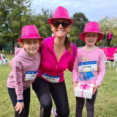 Mother and Daughters posing for photo after completing walk for breast cancer charity